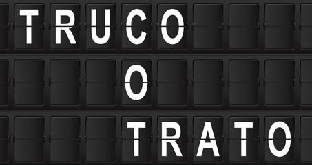 Panel de aeropuerto con texto TRUCO O TRATO