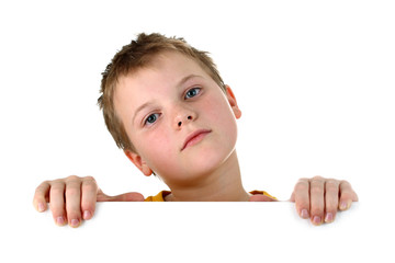 Small boy looking out of a blank whiteboard isolated on white