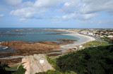 View over Cobo Bay from Le Guet viewpoint poster
