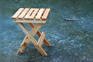 Lonely wooden folding stool