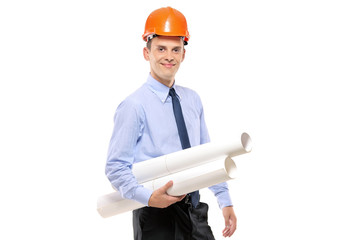 Young architect wearing protective helmet and holding blueprints