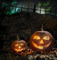 Halloween pumpkins on rocks  at night