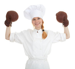 female cook in white uniform and boxing gloves
