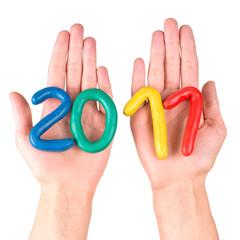 Hands with plasticine figures