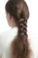 Hair in braid. Long thick plait