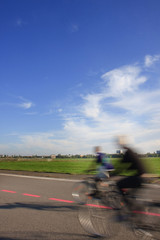 People with bikes on the Tempelhof Airport runway