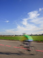 Young man with bike on the Tempelhof Airport runway