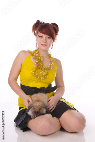 beautiful girl with a rabbit . On a white background.