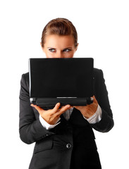 sly modern business woman suspicious looks out from laptop