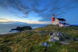 Rocky coastline with lighthouse.