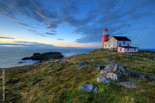 Rocky coastline with lighthouse. - 26770402
