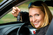 woman shows keys from the new car