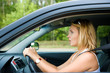 Fright face of woman sitting in car