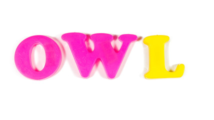 owl written in fridge magnets