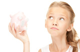 lovely teenage girl with piggy bank - Fine Art prints
