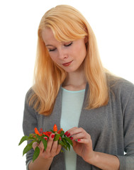 young woman with bunch of chilli, pepperoni