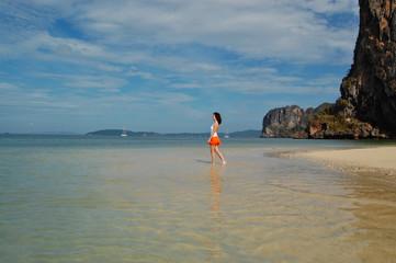 Woman enjoying sea and sun on the beach