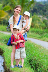 Mother and two kids outdoors