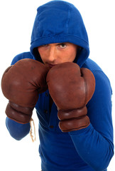 young man in sweatshirt with hood in boxing gloves