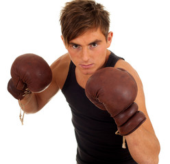 young man wearing a pair of boxing gloves