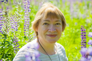 woman in plant of violet wild lupine
