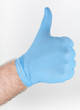 hand in blue glove, making thumbs up gesture
