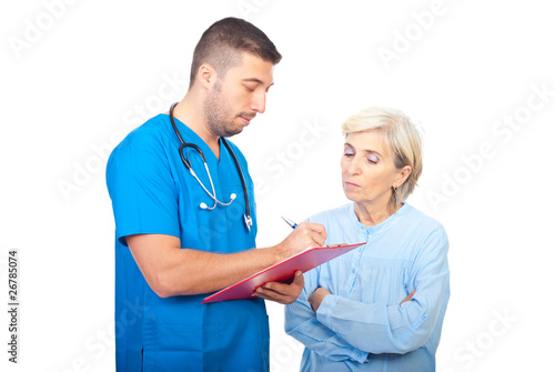Doctor writing prescription for patient