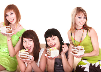 Group of young woman eating cake. Isolated.