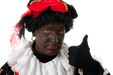 Zwarte Piet ( black pete) typical dutch character with thumbs up