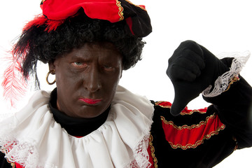 Zwarte Piet ( black pete) typical dutch character with thumbs do