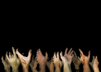 Zombie hands reaching up in the dark