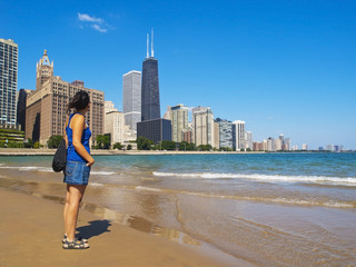 Young woman staring at the beautiful Chicago Skyline