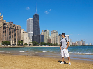 Young man staring at the beautiful Chicago Skyline