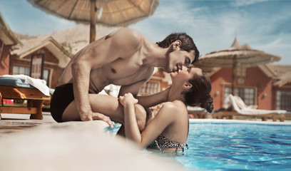 Young couple kissing in a swimming pool