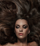 Fototapety Beauty brunette with long hair