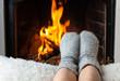 Leinwandbild Motiv Children's feet are heated in the fireplace