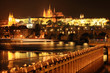 Colorful Prague gothic Castle with Charles Bridge in the Night