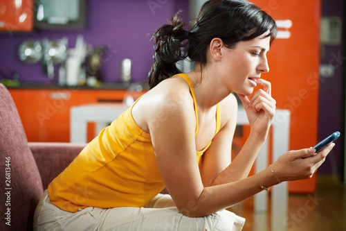 nervous woman holding cellphone