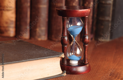 Hourglass And Old Books
