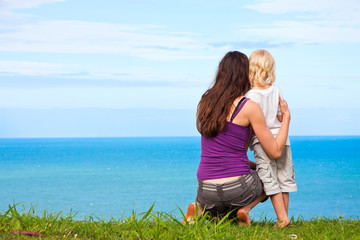 Mother and child looking at a beautiful ocean view