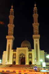 Mosque with two minarents in  night in United Arab Emirates