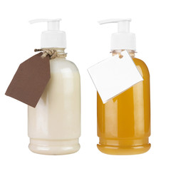 Two plastic bottles of body care