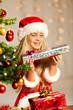 miss santa holding a gift