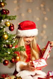 miss santa opening a gift