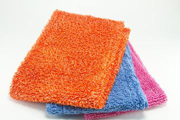 Pile of various multicolor microfibre cloths