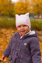 Beautiful baby girl in autumn