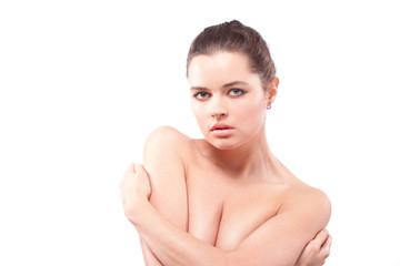 Upset beautiful brunette woman embracing herself