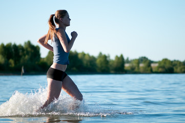 Sport woman running in water
