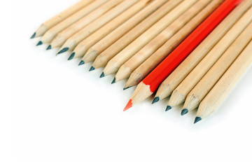 A row of rough graphite pencils with color red one