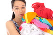 Young Woman with Pile of Washing. Model Released